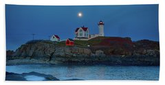Beach Towel featuring the photograph Nubble Lighthouse Lit For Christmas by Jeff Folger