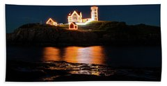 Beach Towel featuring the photograph nubble Lighthouse, York Maine by Jeff Folger