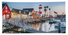 Oceanside Harbor Village At Dusk Beach Towel