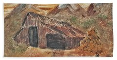 Old Farmhouse With Hay Stack In A Snow Capped Mountain Range With Tractor Tracks Gouged In The Soft  Beach Towel