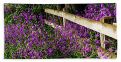 Old Fence And Purple Flowers Beach Towel