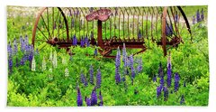 Old Hay Rake And Lupines Beach Towel