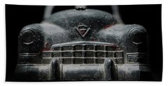 Old Silver Cadillac Toy Car With Specks Of Red Paint Beach Towel by Art Whitton