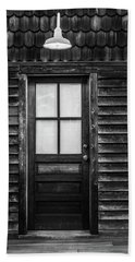 Beach Towel featuring the photograph Old Wood Door And Light Black And White by Terry DeLuco