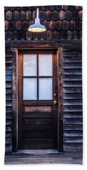 Beach Towel featuring the photograph Old Wood Door And Light by Terry DeLuco