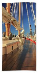 On Deck Of The Schooner Eastwind Beach Towel by Roupen  Baker