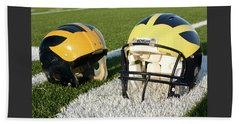 One Old, One New Wolverine Helmets On The Field Beach Sheet