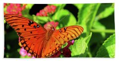 Orange Butterfy On Green Leaves And Pink Flowers Beach Towel