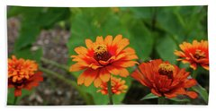 Beach Towel featuring the photograph Orange Flowers by Cathy Harper