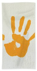 Orange Handprint On A Wall Beach Towel
