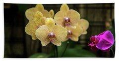 Orange Orchids Beach Towel