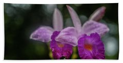 Orchids Love The Rain Beach Towel by Jocelyn Kahawai
