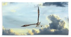Osprey Flying In Clouds At Sunset With Fish In Talons Beach Towel