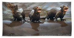 Otter Pup Triplets Beach Towel