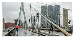 Beach Towel featuring the photograph Over The Erasmus Bridge In Rotterdam With Red Umbrella by RicardMN Photography