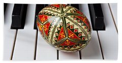 Painted Easter Egg On Piano Keys Beach Towel