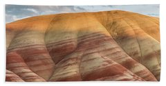 Painted Hill At Last Light Beach Towel by Greg Nyquist