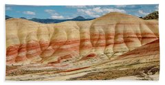 Painted Hills And Afternoon Sky Beach Sheet by Greg Nyquist
