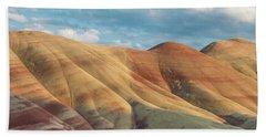 Painted Ridge And Sky Beach Towel by Greg Nyquist