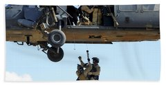 Pararescuemen Are Hoisted Into An Hh-60 Beach Towel