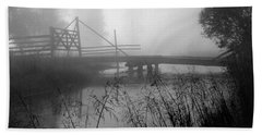 Part Of The Snake River Passes Under A Wooden Bridge Beach Towel by Wernher Krutein