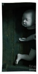 Parts Of A Plastic Doll In A Wooden Box Beach Sheet by Lee Avison