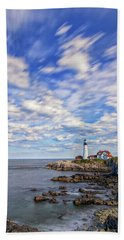 Passing Clouds At Portland Head Light Beach Towel