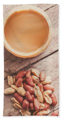 Peanut Butter Jar With Peanuts On Wooden Surface Beach Towel
