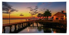 Pelican Cafe Sunrise Beach Towel by Tom Claud