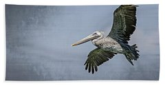 Beach Towel featuring the photograph Pelican Flight by Carolyn Marshall