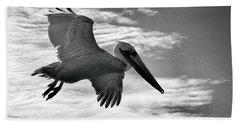 Pelican In Flight Beach Towel