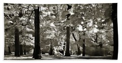People Resting In The Park Beach Towel by Odon Czintos