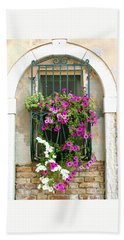 Beach Towel featuring the photograph Petunias Through Wrought Iron by Donna Corless