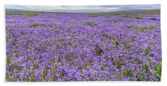 Phacelia Field And Clouds Beach Towel