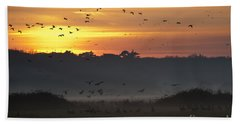 Pink Footed Geese At Holkham Norfolk Uk Beach Towel