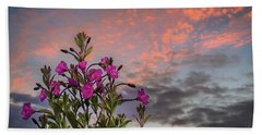 Beach Towel featuring the photograph Pink Wildflowers At Sunset by James Truett