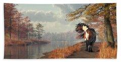 Pinto Horse On A Riverside Trail Beach Towel by Daniel Eskridge