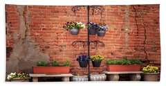 Beach Towel featuring the photograph Potted Plants And A Brick Wall by James Eddy