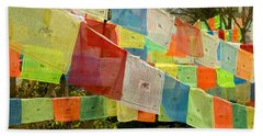 Prayer Flags Hang In A Forest Beach Towel