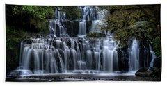 Purakaunui Falls Beach Towel by Brad Grove