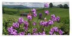 Beach Towel featuring the photograph Purple Flower In Landscape by Emanuel Tanjala