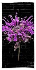 Purple Flower Under Bricks Beach Towel by Walt Foegelle