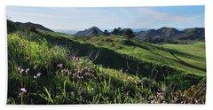 Beach Sheet featuring the photograph Purple Flowers And Green Hills Landscape by Matt Harang