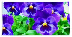 Beach Towel featuring the photograph Purple Pansies by Wendy McKennon
