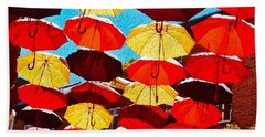 Beach Towel featuring the painting Raining Umbrellas by Joan Reese