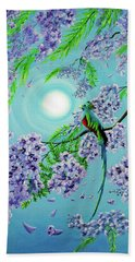 Quetzal Bird In Jacaranda Tree Beach Towel by Laura Iverson