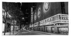 Radio City Music Hall Nyc Black And White  Beach Towel by John McGraw