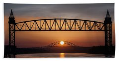 Railroad Bridge Framing The Bourne Bridge During A Sunrise Beach Towel