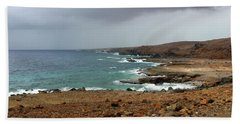 Rain Clouds Brewing Off The Coast Of Island Of Aruba Beach Towel