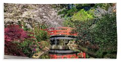 Red Bridge Spring Reflection Beach Towel by James Eddy